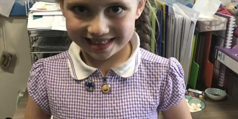 Olivia - First blue merit badge winner